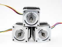 Stepper motors with wires, isolated on white. Stepper motors are brushless DC electric motor that divides a full rotation into a number of equal steps. They have Royalty Free Stock Images