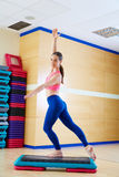Stepper step woman exercise workout at gym Royalty Free Stock Photo