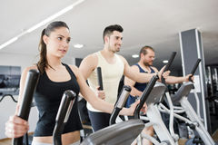 Steppers exercises at gym Royalty Free Stock Photos