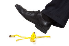 Stepping on a Banana Peel. A man's foot about to slip on a banan peel, Danger or accident concept Royalty Free Stock Images