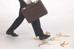 Stepping on banana peels Stock Photo