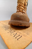 Stepping on the Constitution. Boot of oppression stepping on the U.S. Constitution Royalty Free Stock Image