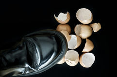 Stepping on eggshells Royalty Free Stock Images