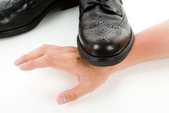 Stepping on a hand Stock Image