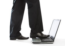 Stepping on laptop Royalty Free Stock Image