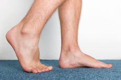 Stepping male feet Stock Photography