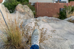 Stepping off a cliff Royalty Free Stock Photography