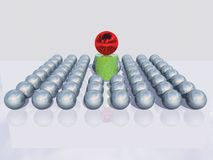 Stepping Out of the Crowd. Conceptual image of a red ball stepping out of the crowd of silver balls Stock Image