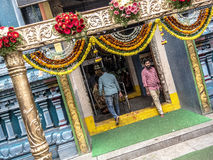 Stepping out from the temple in India Stock Photos