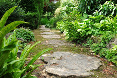 Stepping Stone Garden Path. Stepping Stone Path in a Peaceful Green Garden - Low Angle View with a Shallow Depth of Field Royalty Free Stock Photos