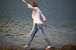 Stepping on Stones. Walking on the water front in Maine Royalty Free Stock Images