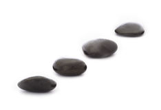 Stepping Stones. Four black stepping stones on white background Royalty Free Stock Photos