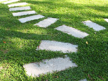Stepping Stones. Laid on a field of green grass stock photo