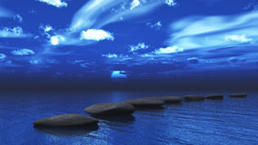 Stepping stones across the ocean Stock Photography