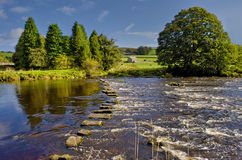 Stepping stones across river Royalty Free Stock Photos