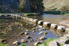 Stepping stones. Across the river Dove, Derbyshire Stock Photos
