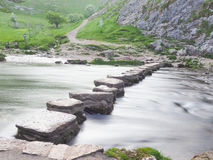 Stepping Stones at Dove Dale. Long exposure taken at dawn of water flowing through the Stepping Stones at Dove Dale in Derbyshire Royalty Free Stock Image