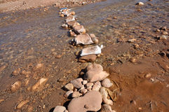 Stepping stones over the river Royalty Free Stock Photography