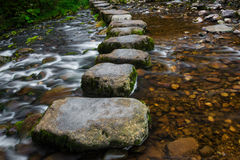 Stepping stones. Over river and small waterfall Stock Image