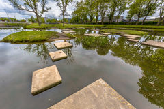 Stepping stones in pond of public park Royalty Free Stock Photos