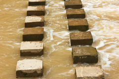 Stepping Stones. Stepping stones to cross  in the rainy season Stock Images