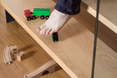 Stepping on toy Stock Images