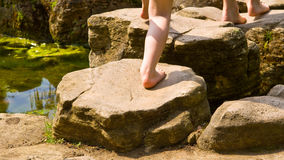 Stepping up a rock. Child stepping up a rock. Focus on the right foot Stock Photos