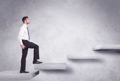 Stepping up a staircase Royalty Free Stock Photos