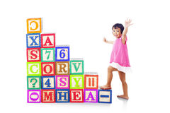 Stepping upward on alphabet block Royalty Free Stock Images