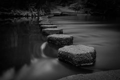 Steppings stones. Long exposure of stepping stones across a river Royalty Free Stock Photography