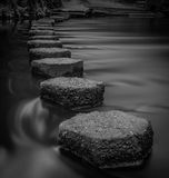 Steppings stones. Long exposure of stepping stones across a river Stock Photography