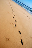 Stepprints. Steps on sand with sea background stock photo