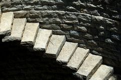 Steps. Stone steps against stone wall background Royalty Free Stock Images