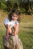 On the steps. Little girl climbing wooden steps at the playground Royalty Free Stock Photos