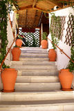 Steps. To the greek taverna on terrace royalty free stock photography