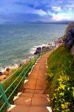 Steps. Cliffside steps leading to waters edge,near Dalkey,Dublin Bay, Ireland Royalty Free Stock Photography