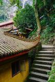 Steps by aged Chinese buildings on woody mountainside Stock Photos