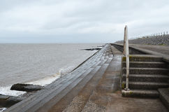 Steps along Silloth seafront,Cumbria. Steps along Silloth seafront on a cloudy grey day,Cumbria Stock Photos
