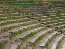 The steps of the ancient amphitheater, overgrown with grass. Royalty Free Stock Photo