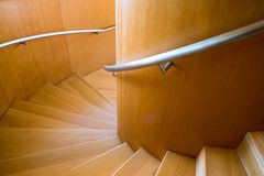 Steps ascending a wood clad spiral staircase royalty free stock photo