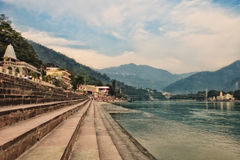 The steps of the ashram. At the shore of the sacred river Ganges. India, Rishikesh Stock Images