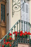 Steps and beautiful doors with flowers. Front door, European house Royalty Free Stock Photography