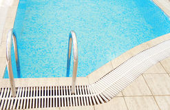 Steps in a blue water pool Stock Photo