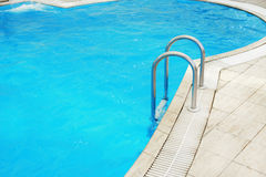 Steps in a blue water pool Royalty Free Stock Photography