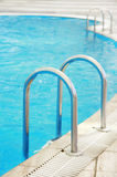 Steps in a blue water pool Stock Image