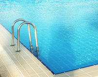 Steps in blue water pool Royalty Free Stock Photography