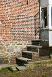 Steps in brick wall. Bosham. England Royalty Free Stock Images