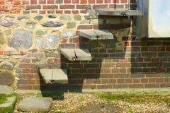Steps in brick wall. Bosham. England Stock Photo