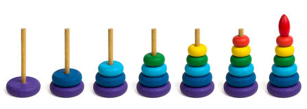 The steps of building a toy pyramid Stock Photography