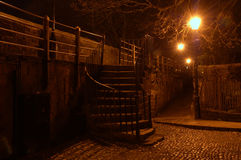 Steps in The Dark. Steps onto the Roman Wall in Chester at night lit up by streetlamps Stock Photo